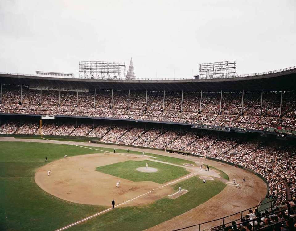 August 20, 1961 Cleveland Municipal Stadium. First game of a Cleveland Indian/NY Yankee doubleheader. Dick Stigman pitching in relief of Jim Perry to Roger Maris with Mickey Mantle on deck. Final score Yankees 6, Cleveland 0. In this game Mantle hit home run number 46 in the 1st inning and Maris hit number 49 in the 3rd. For more images visit www.ballparkprints.com